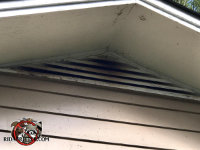 Bat guano and stains on a gable vent in Atlanta