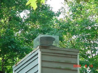 Chimney cap used to exclude birds from a house in Smyrna, Georgia