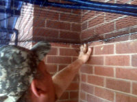 Bird control supervisor checking a bird netting installation in Atlanta