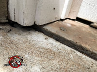 The concrete settled and opened up a mouse gap under the door trim at a house in Tyrone Georgia