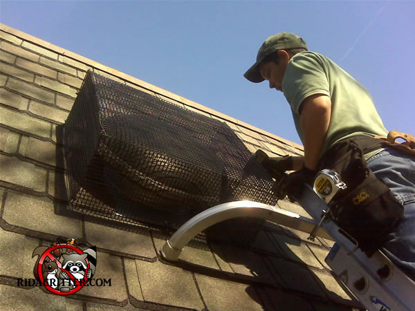 Sealing animals out of a roof vent in Atlanta.
