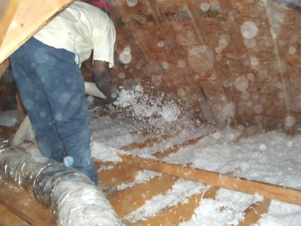 Insulation being installed in an attic in Decatur